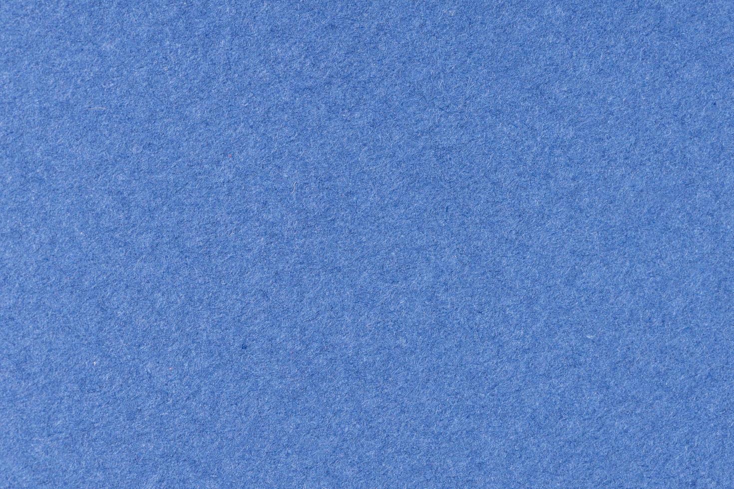 blå texturerat papper bakgrund. full ram foto