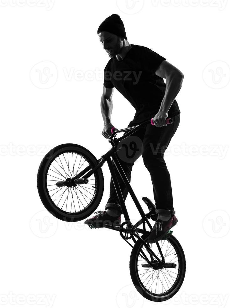 man bmx akrobatisk figur siluett foto