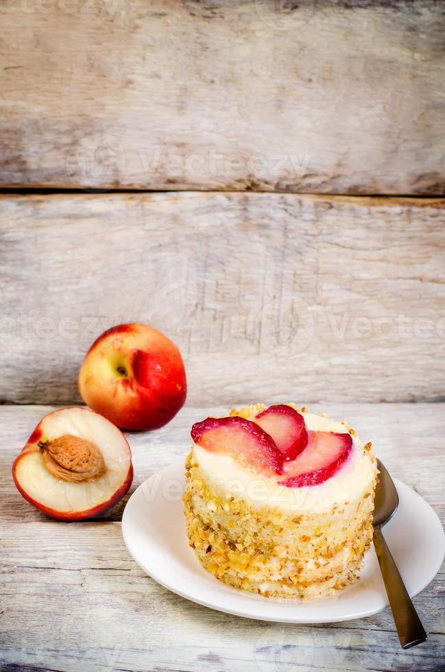 ostkaka mini med persikor foto