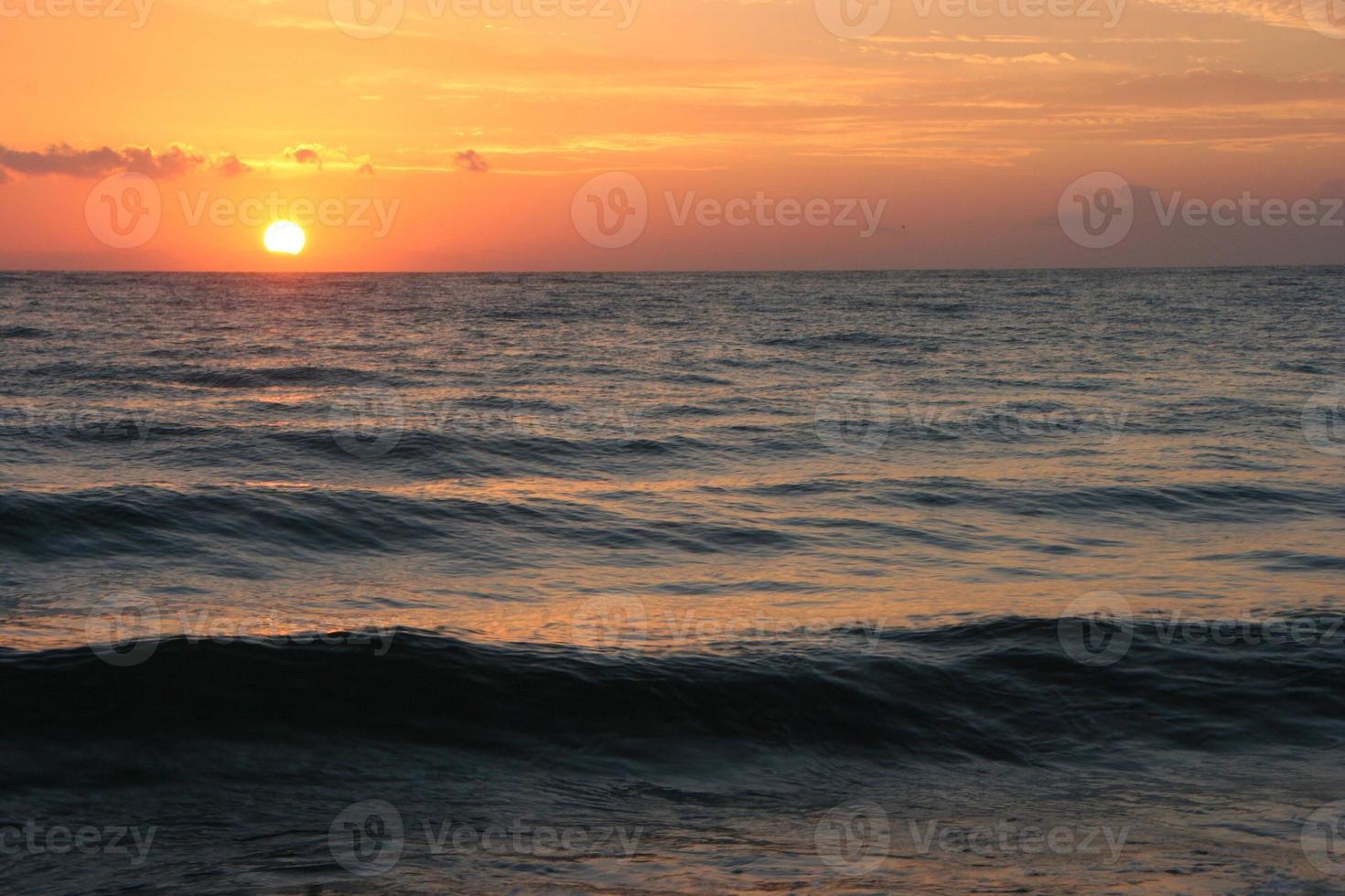 havssolnedgång / soluppgång foto