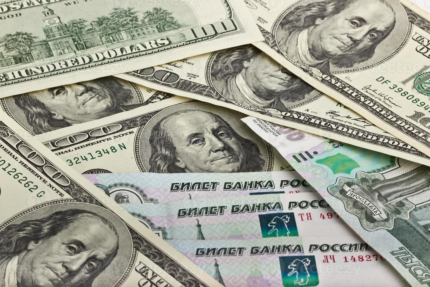 amerikanska och ryska pengar foto