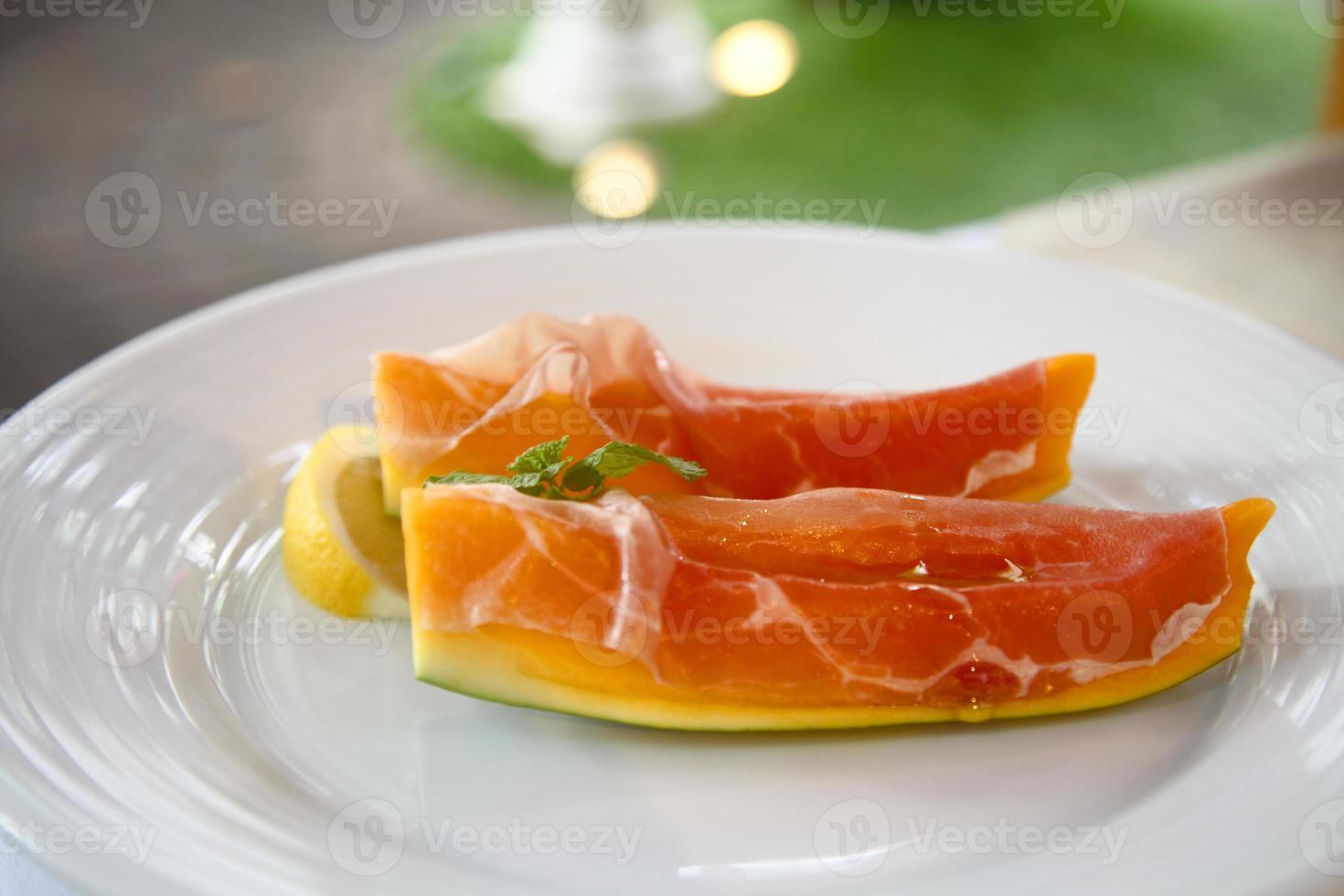 prosciutto med mango foto