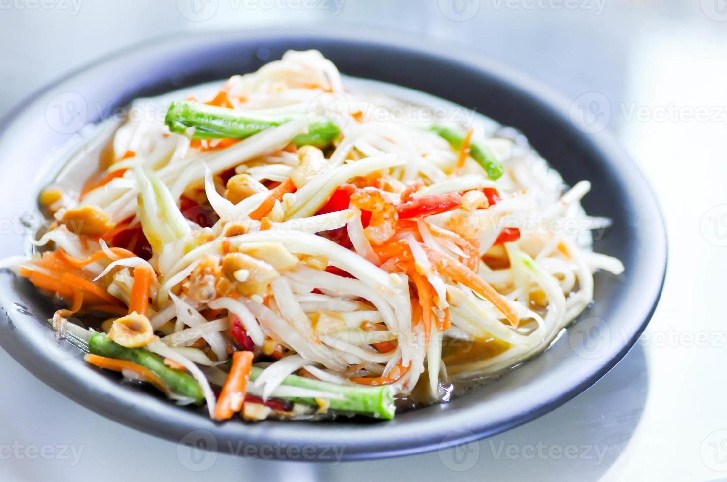 papayasallad, grönsakssallad, kryddig sallad, thailändsk sallad foto