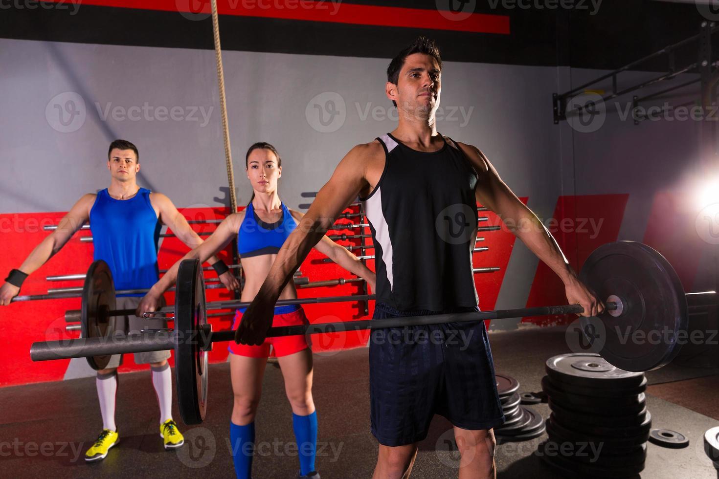 skivstång viktlyft grupp träning gym foto