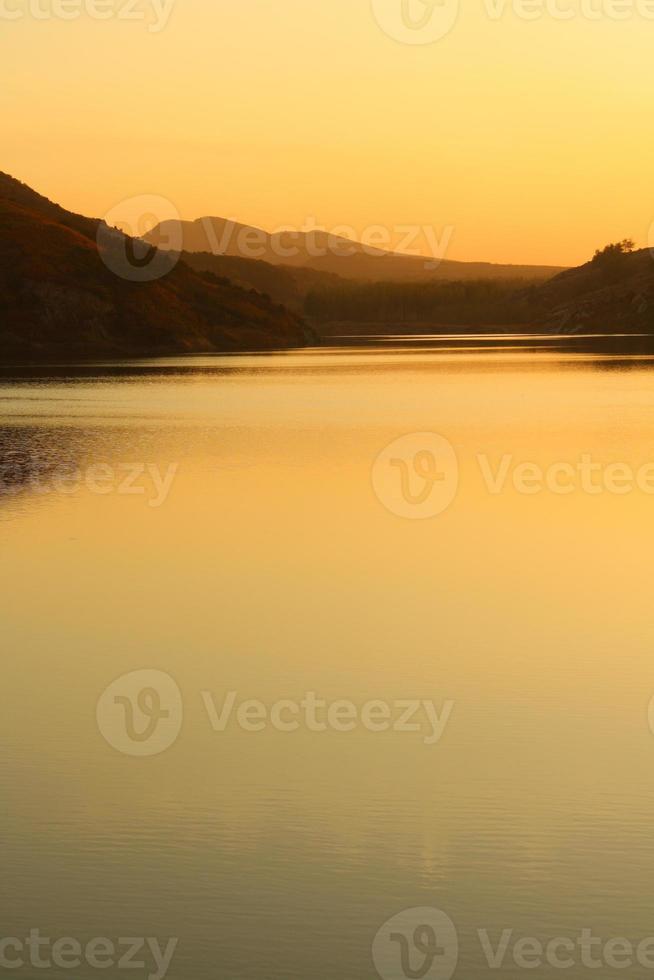 solnedgång sjö foto