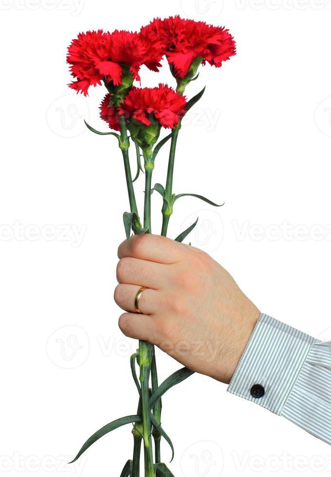 nejlikor i en mans hand foto