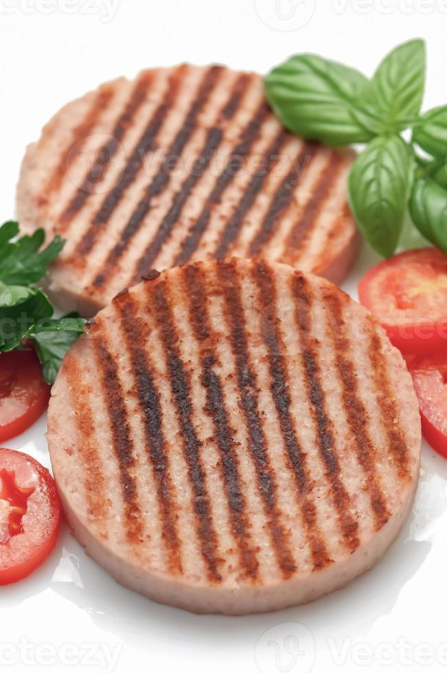 skinka hamburgare med tomater foto