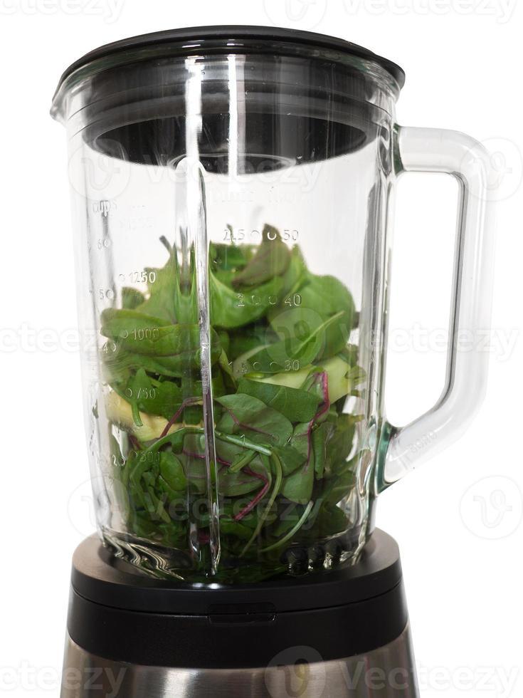 blandare med ingredienser för en grön smoothie foto