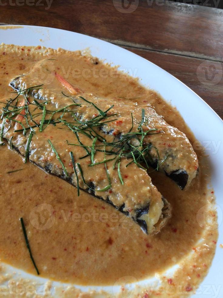 friterade curried fiskpatties foto