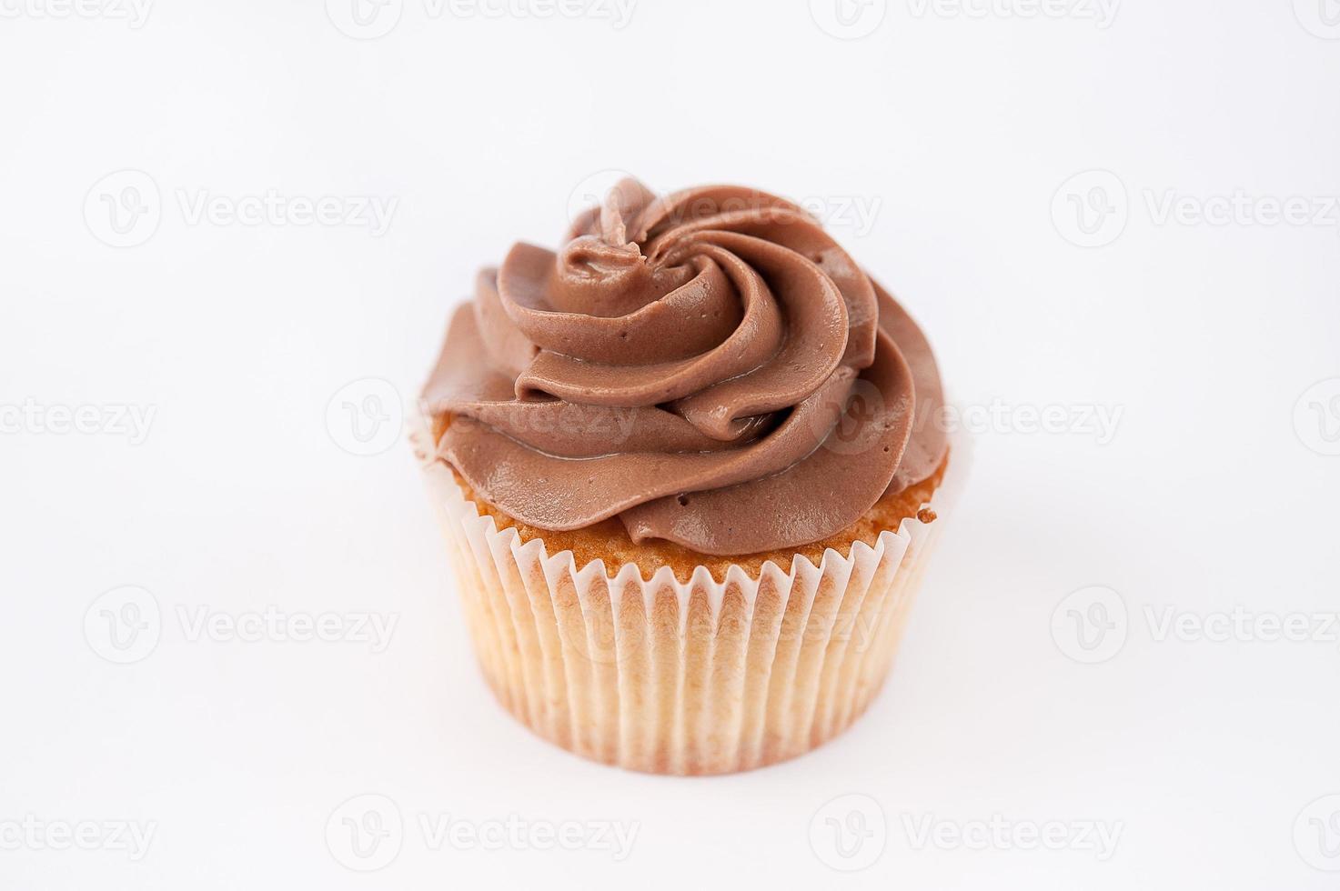 vackra muffins med chokladkräm foto