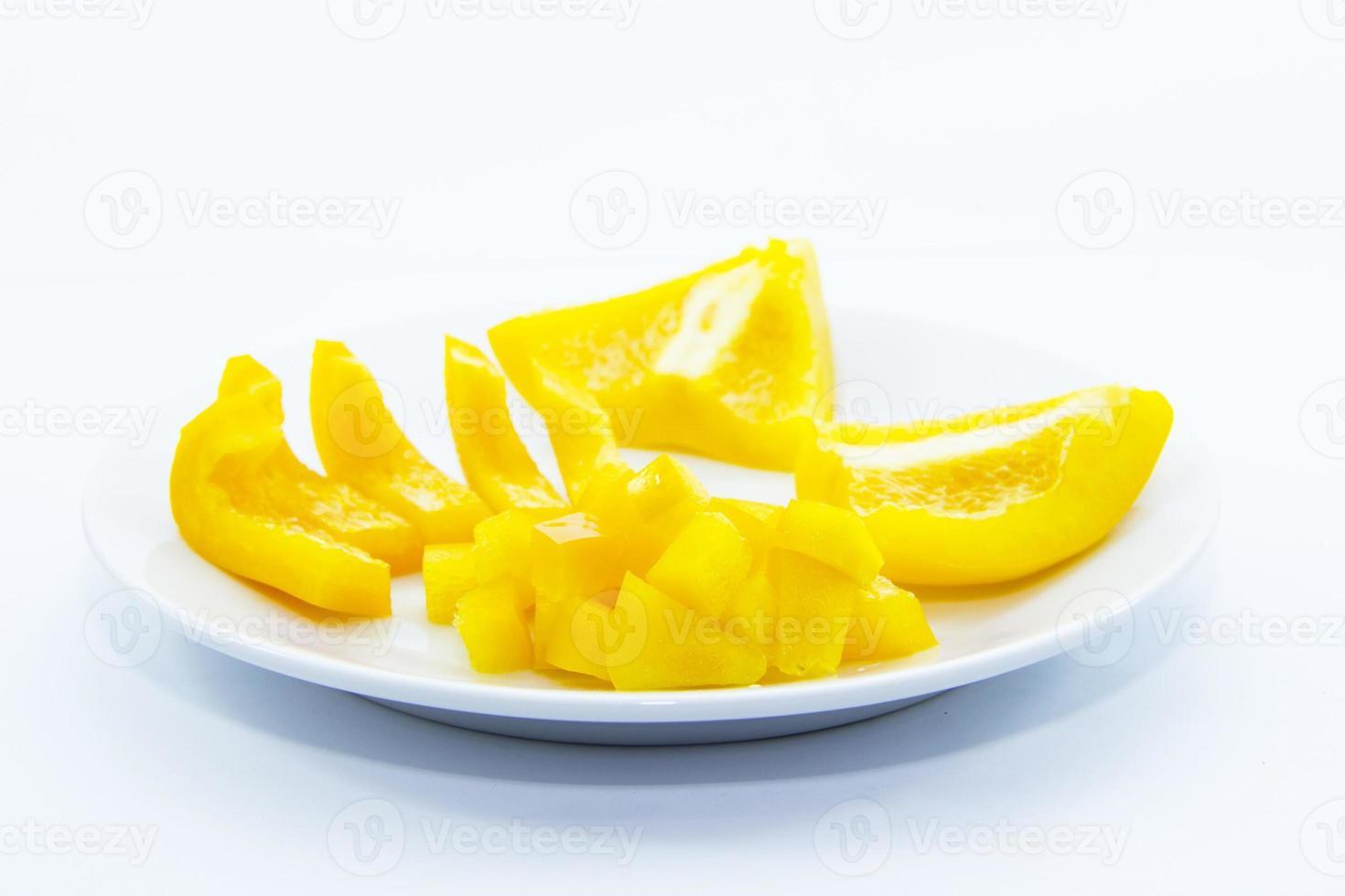 skivad och hackad gul bell chiliingrediens foto