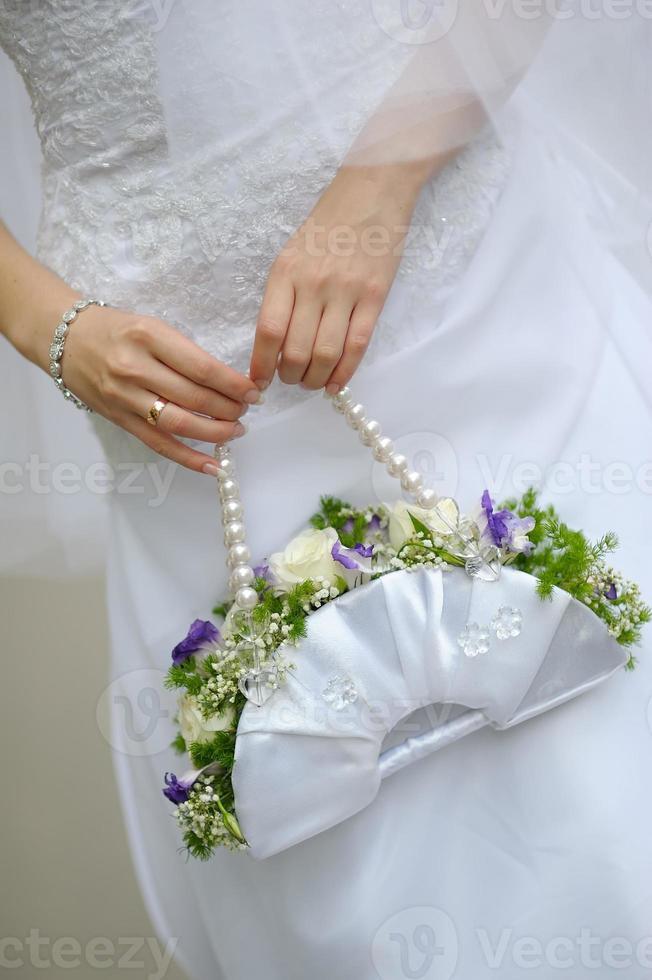 brud med en bröllopsbukett foto