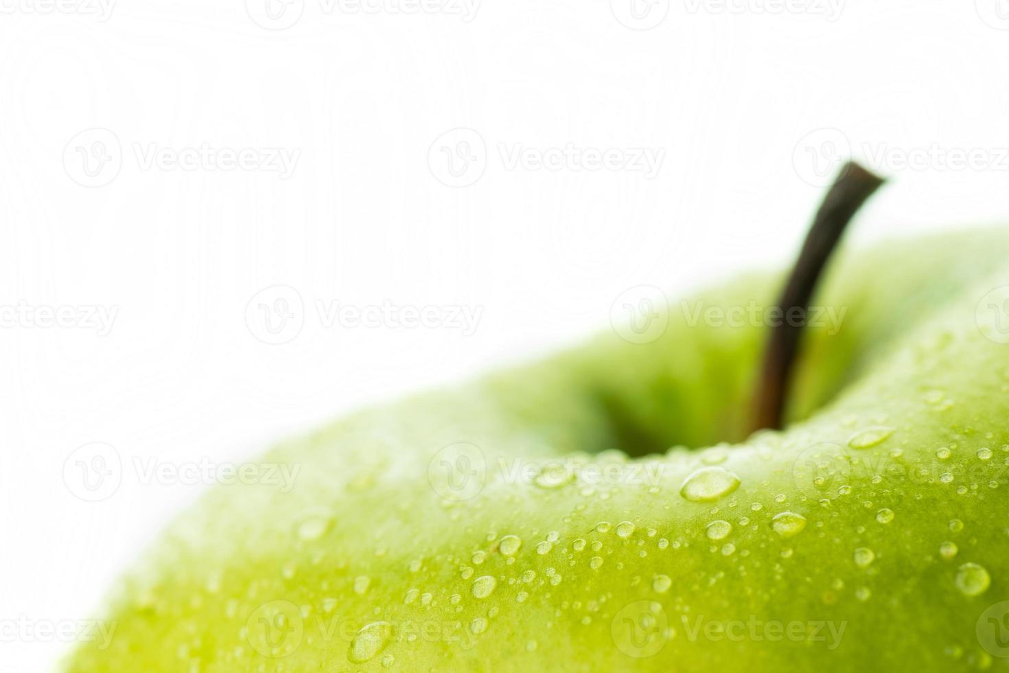 grönt äpple på nära håll foto