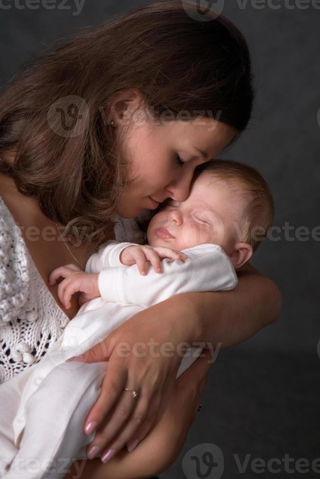 barn och mamma foto