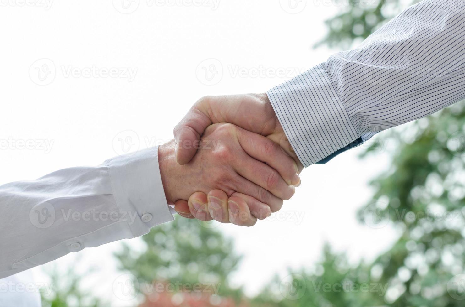handslag foto