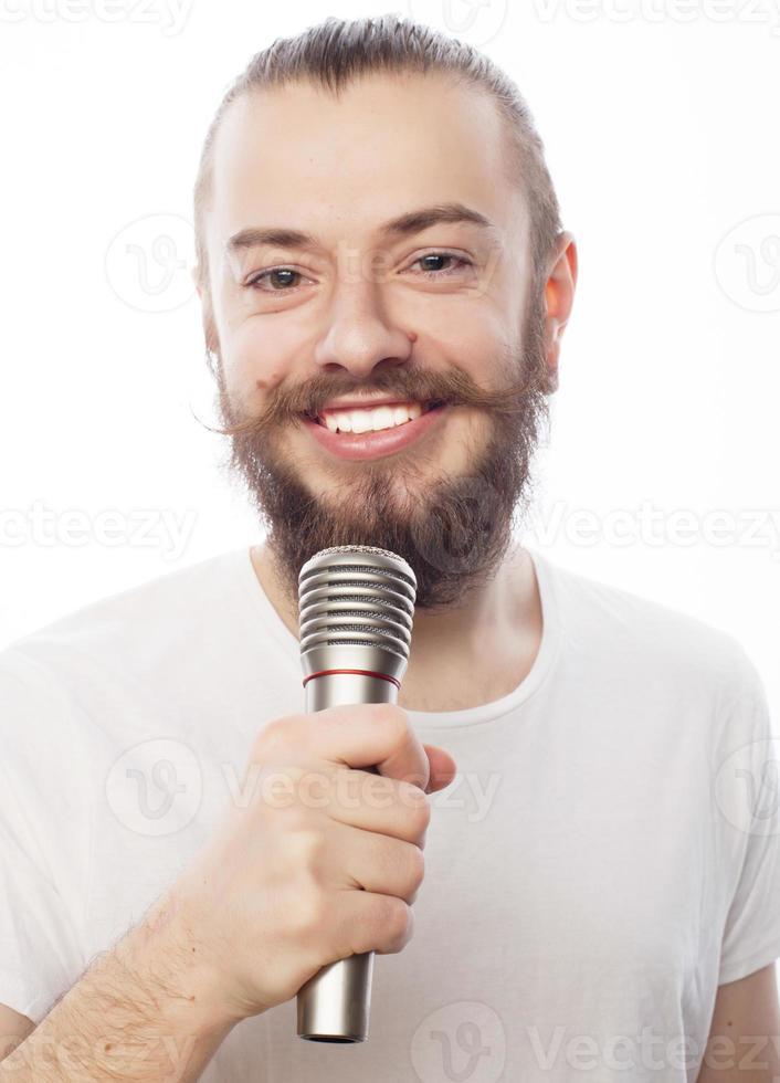 man med mikrofon foto