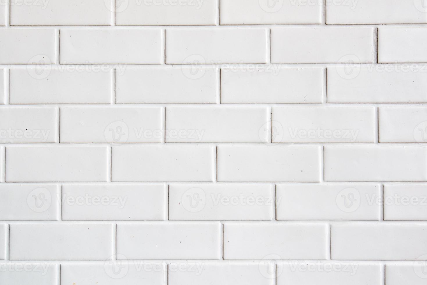 vit tegelvägg med hög upplösning. foto