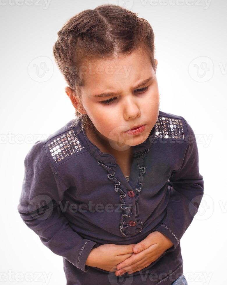 sjuka lilla flickan smärta i magen, smärta i magen foto