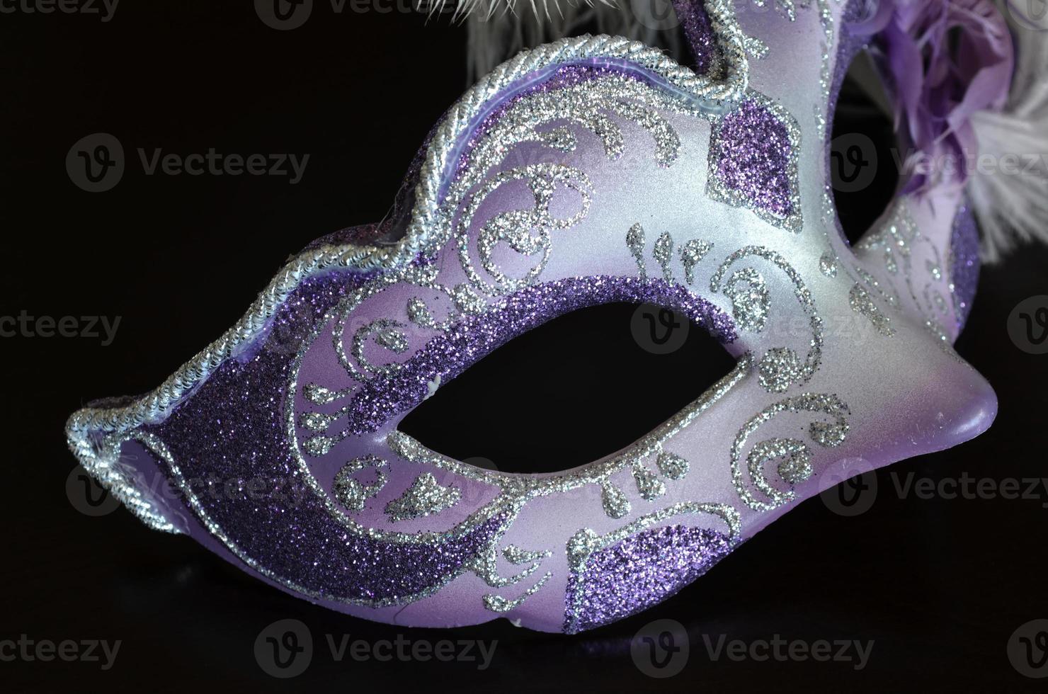 venetiansk mask med fjädrar foto