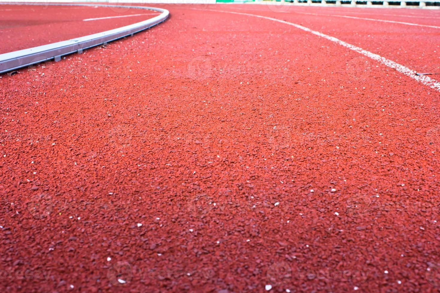 löparbana gummistandard röd färg foto