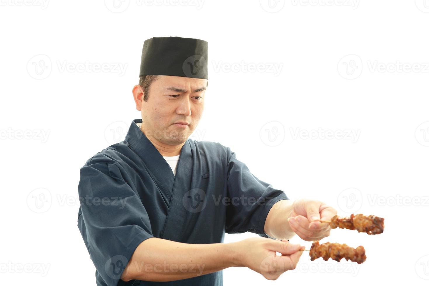 arbetar asiatisk kock foto