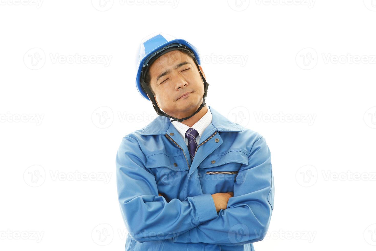 deprimerad asiatisk arbetare foto