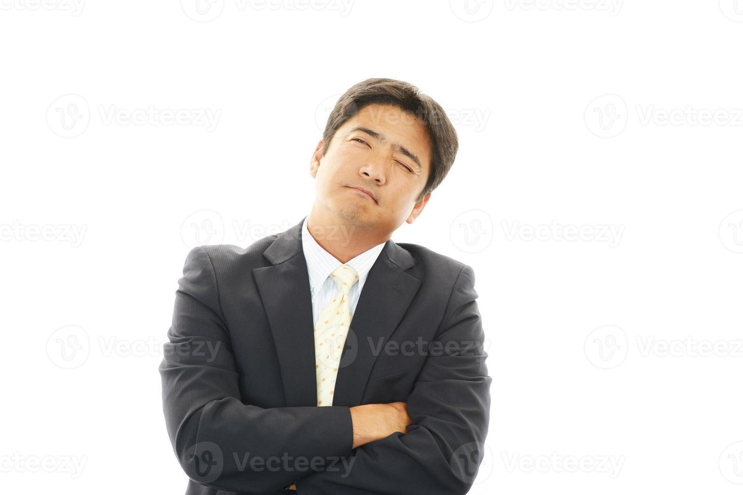 missnöjd asiatisk affärsman foto