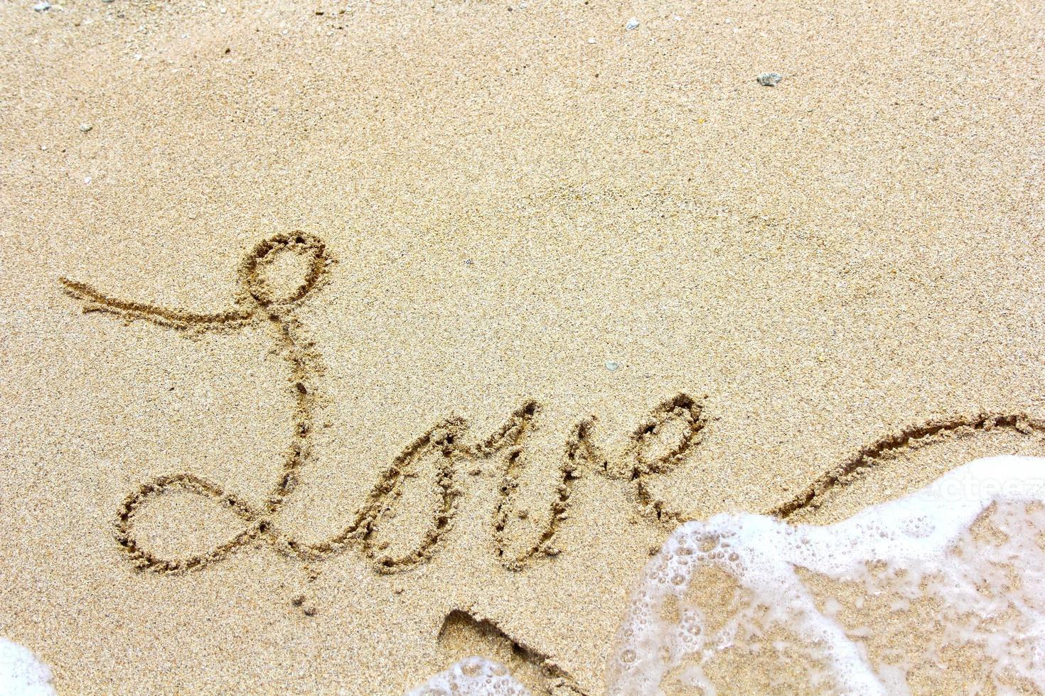 kärlek i sanden foto