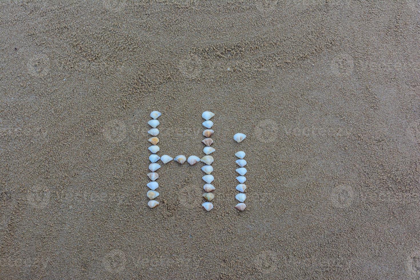 text på sanden foto
