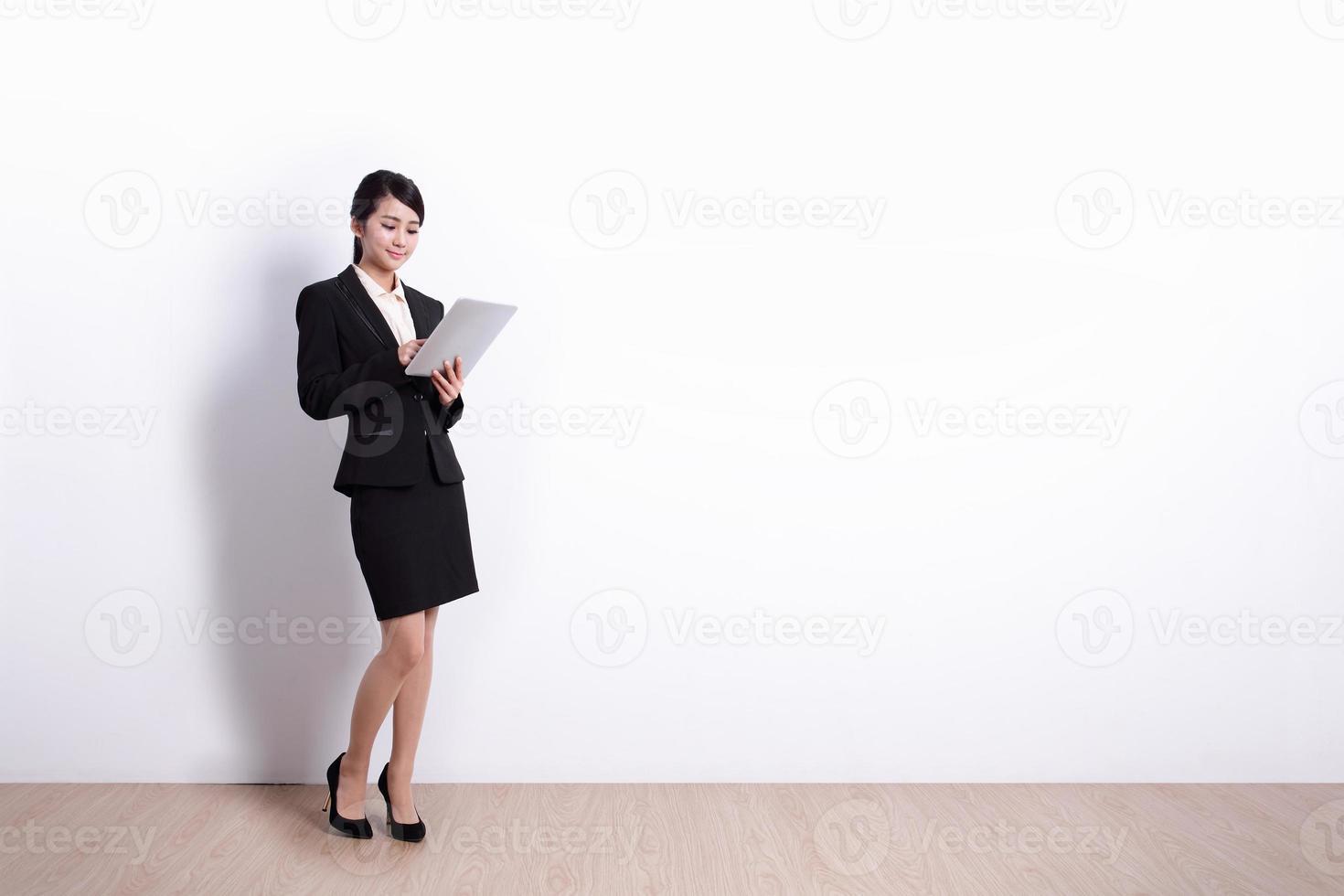 affärskvinna med TabletPC foto