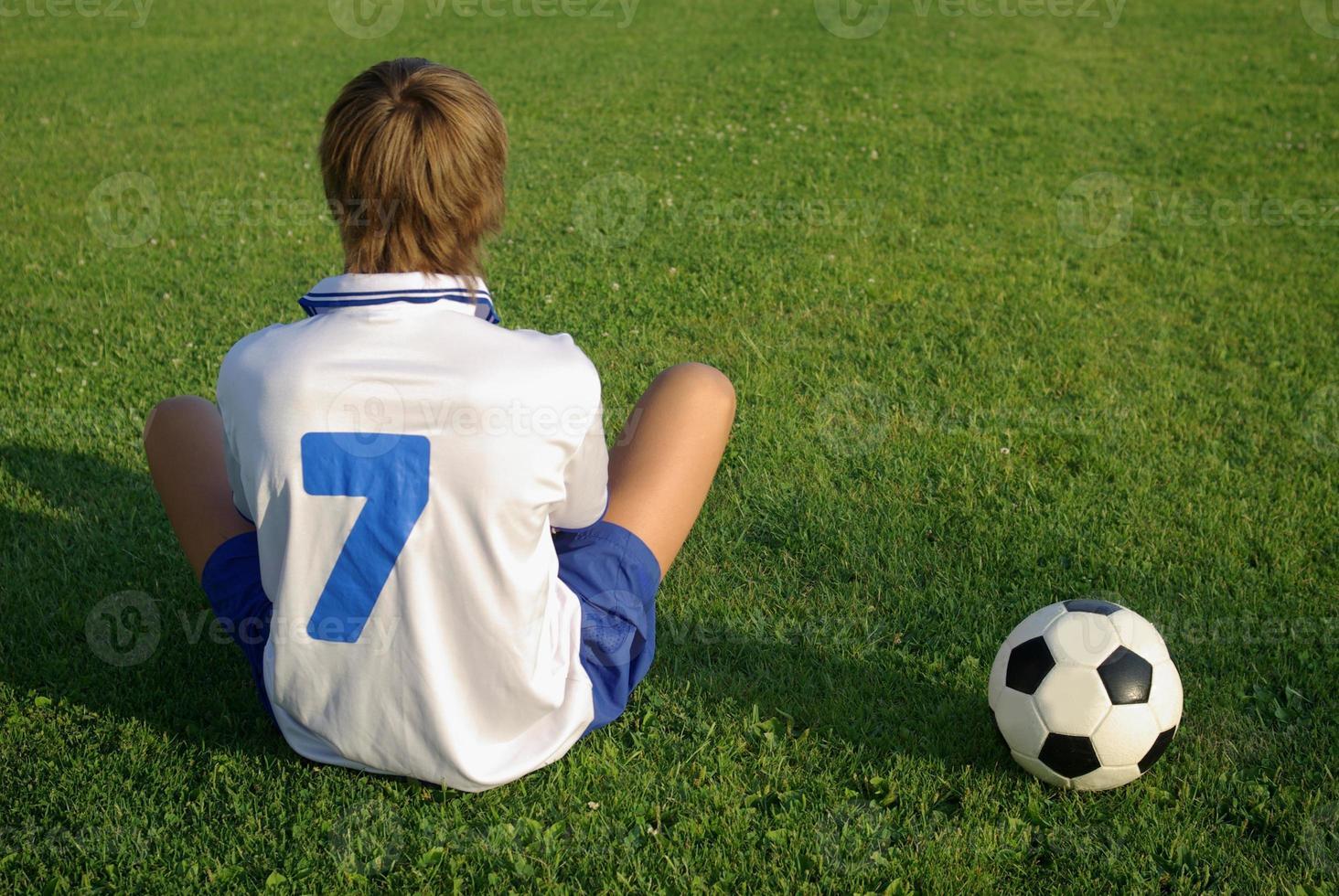 pojke med en fotboll foto