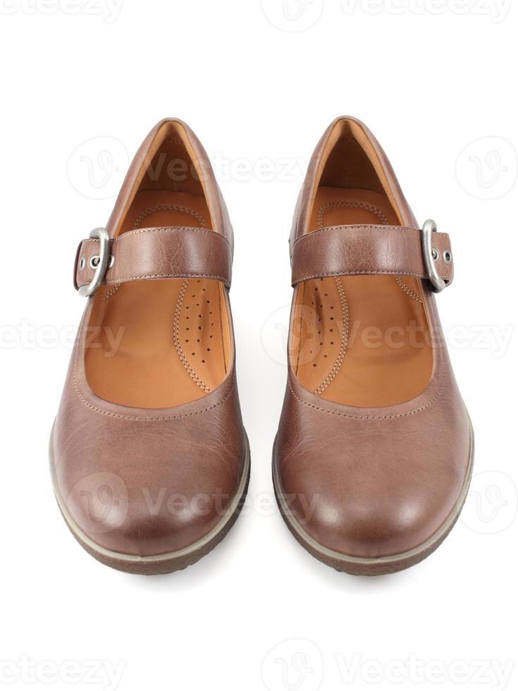 avslappnade bruna läderskor foto