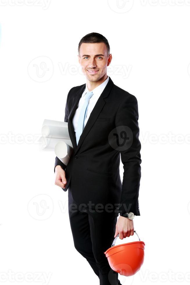 glad affärsman innehav hjälm foto