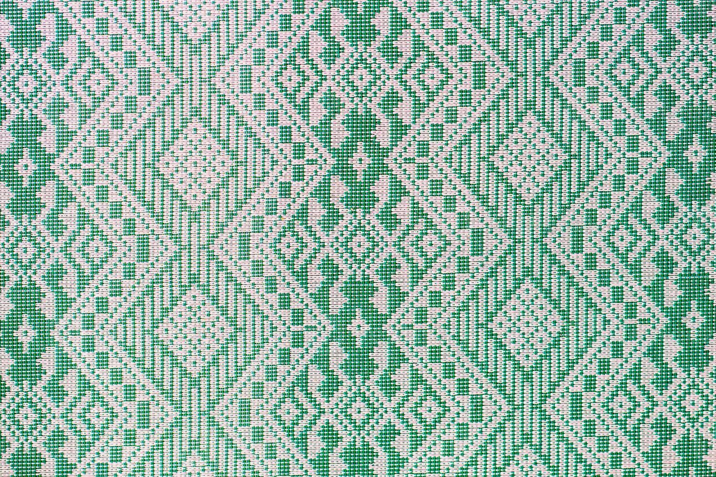 thailändskt silkegrönt mönster, Thailand textilstil foto