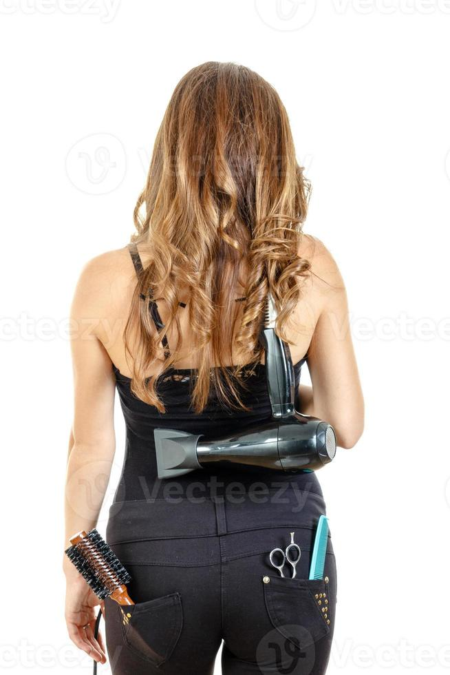professionell kaukasisk brunett kvinnlig frisör poserar från b foto