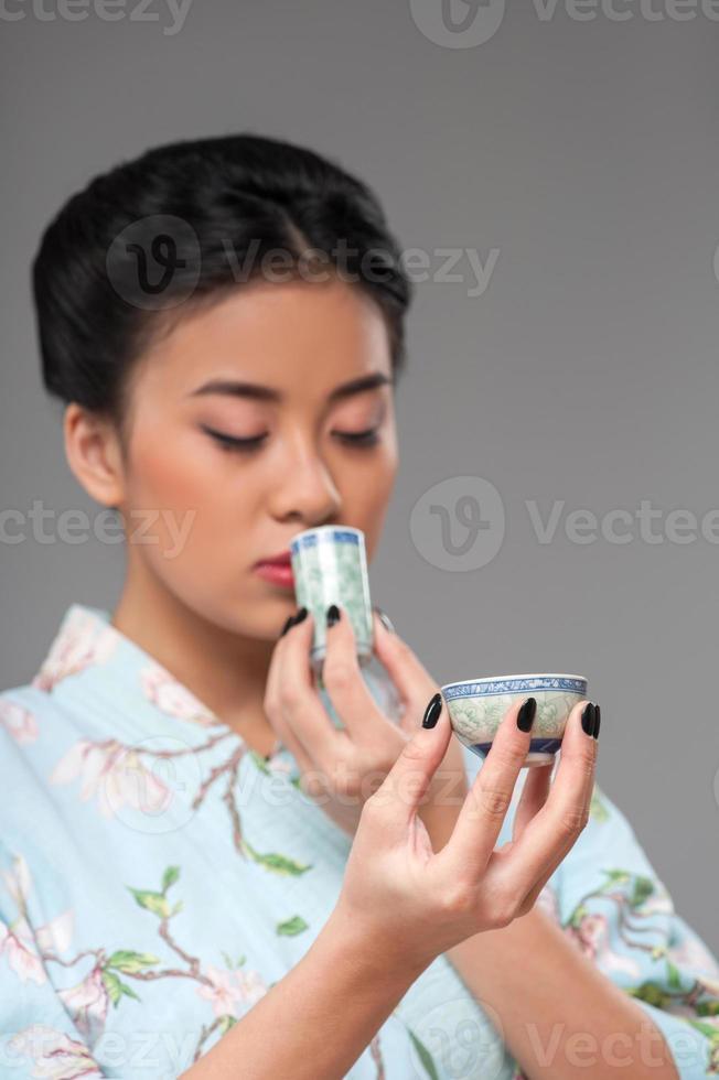 njuter av asiatisk teceremoni foto