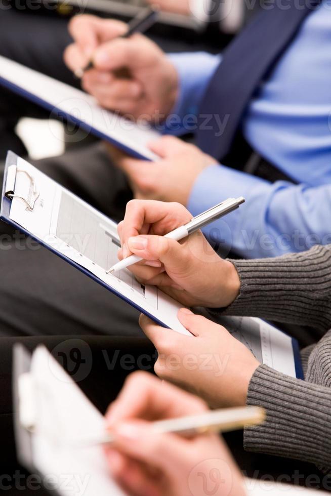 skriva anteckningar foto