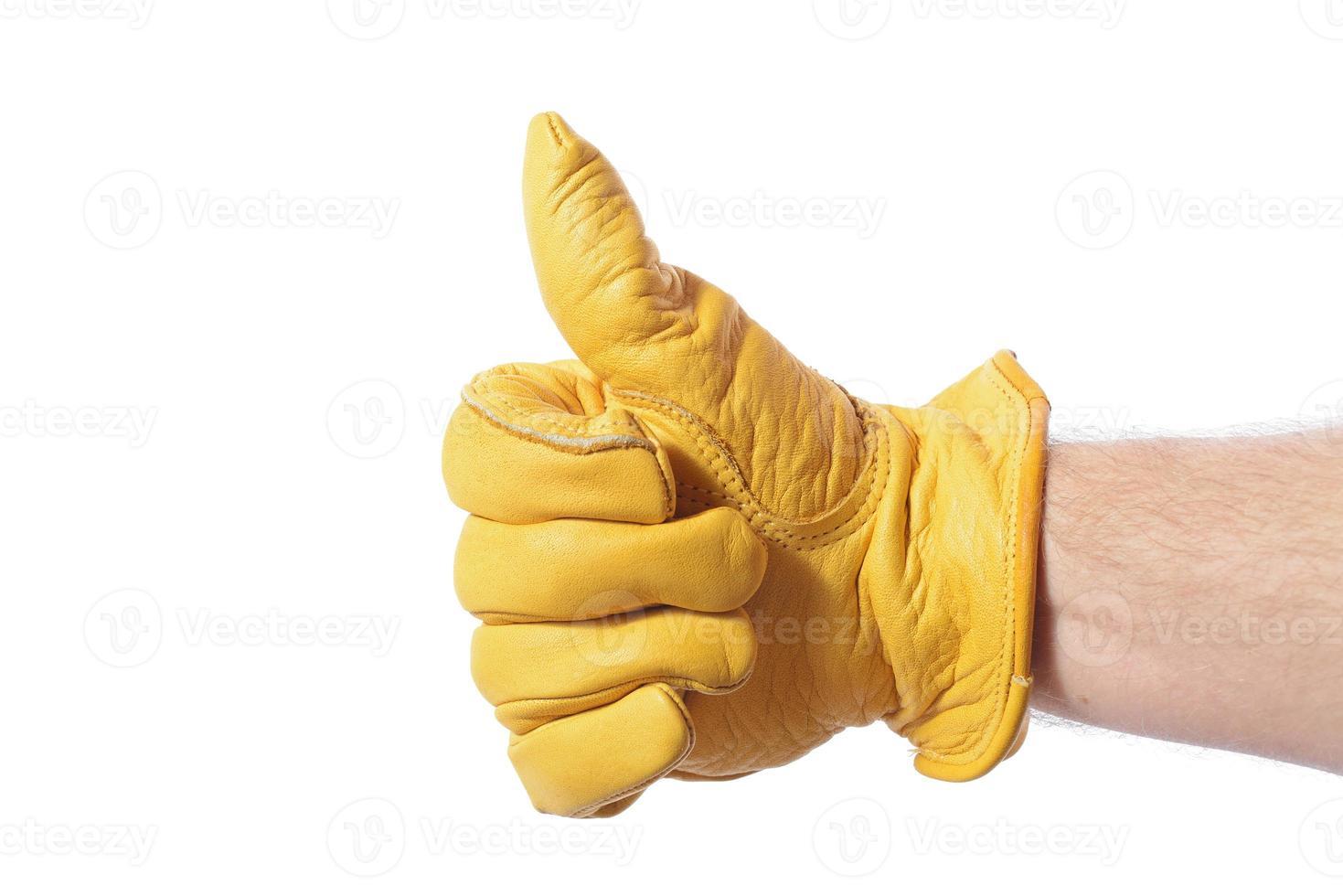 konstruktionshandske tummen upp foto