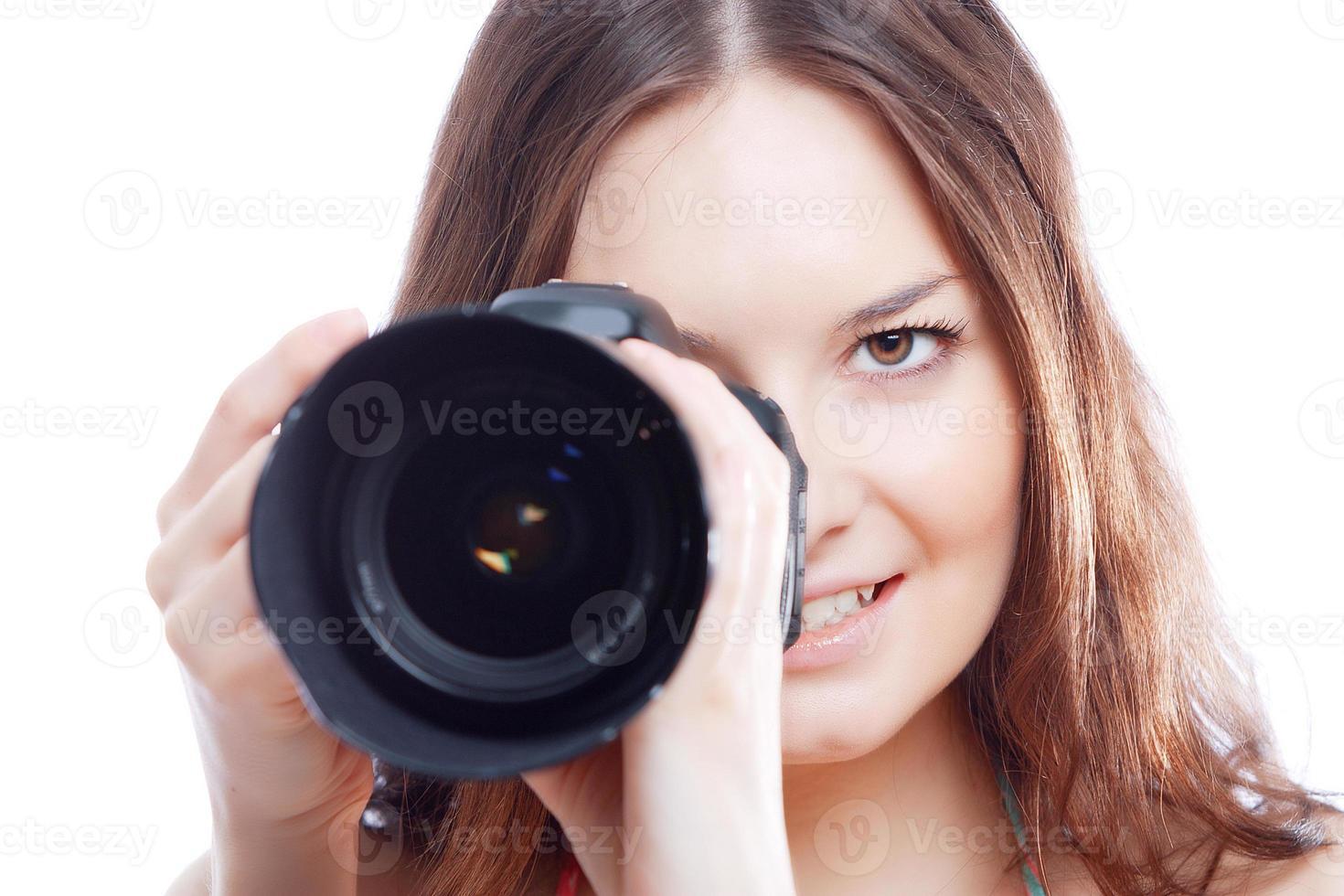 le kvinna med professionell kamera foto