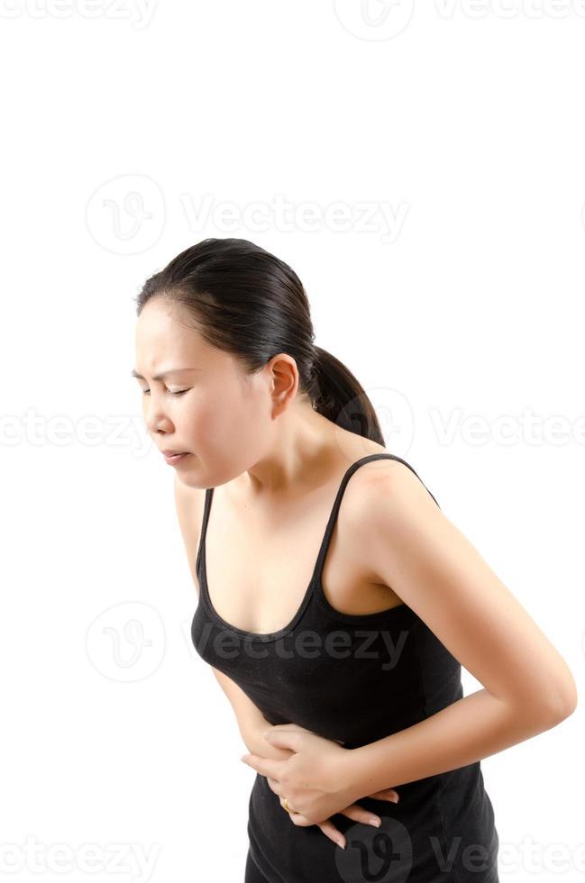 asiatisk kvinna buksmärta. foto