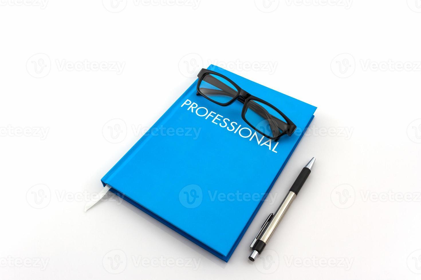 "blå dagbok med ordet ""professionell"" på vit bakgrund foto"