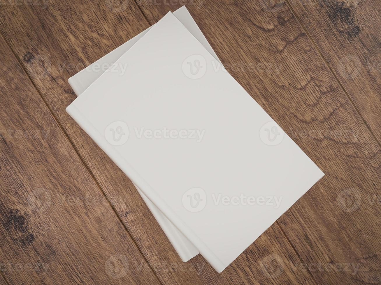 tom vitbokmodellmall på träbakgrund foto