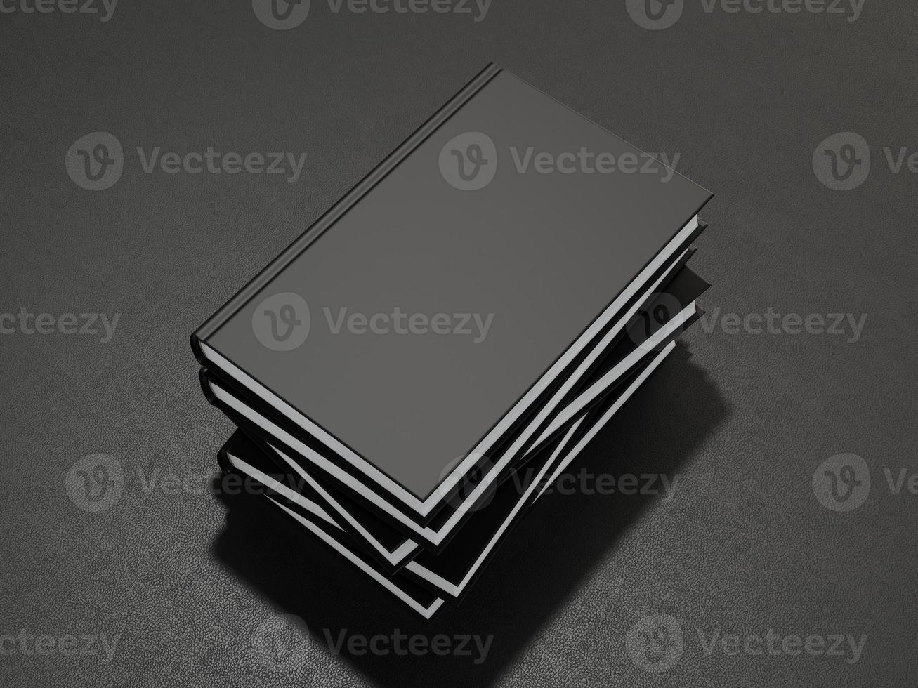 några böcker med svart tomt omslag foto