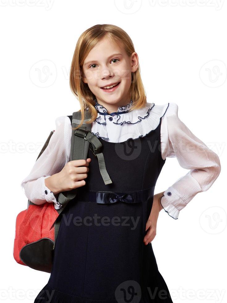 flicka stående med isolerad skolväska foto