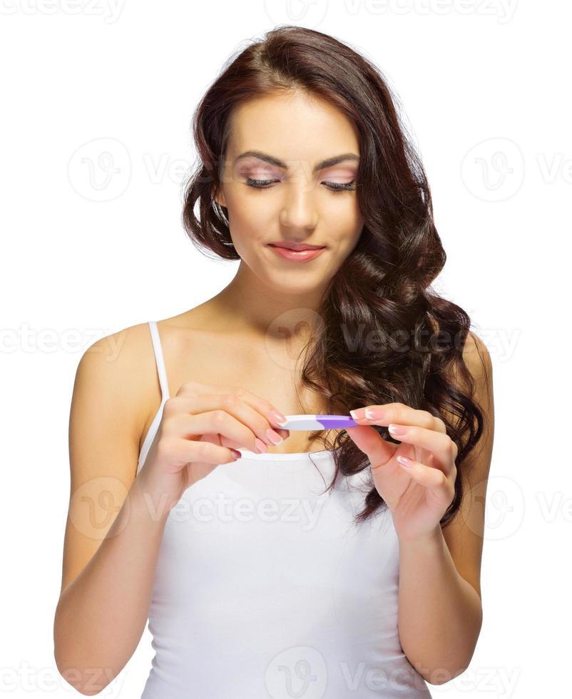 frisk tjej med graviditetstest foto
