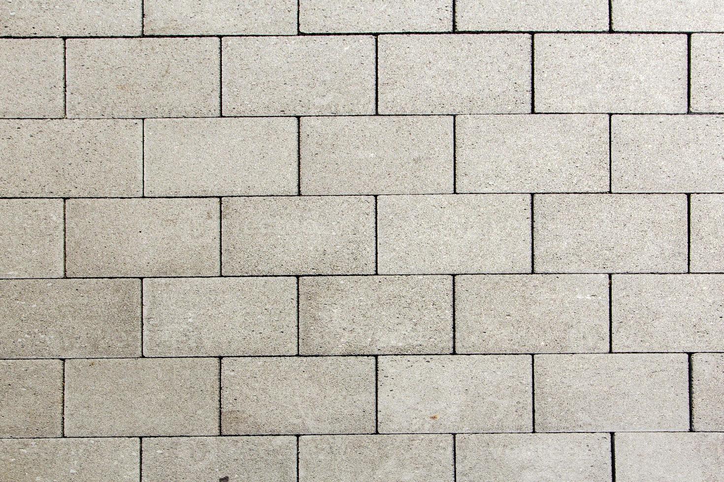 detalj av plattor på gatan ger ett harmoniskt mönster foto