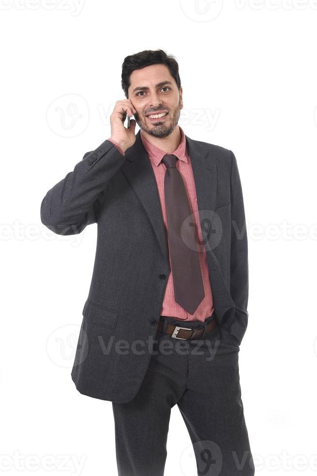 företag porträtt attraktiv affärsman leende med mobiltelefon foto