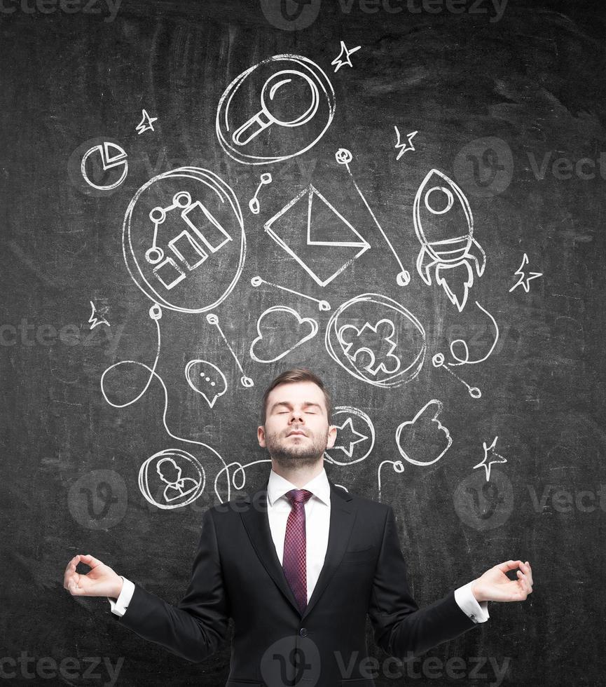 meditativ affärsman foto