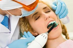 läker tänder foto