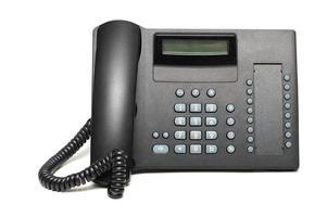 kontortelefon isolerad på den vita bakgrunden foto
